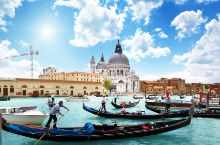 gondolas on Canal and Basilica Santa Maria della Salute, Venice, Italy Stock Photo