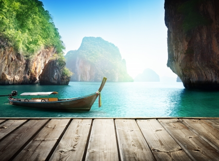 krabi: Adaman sea and wooden boat in Thailand Stock Photo