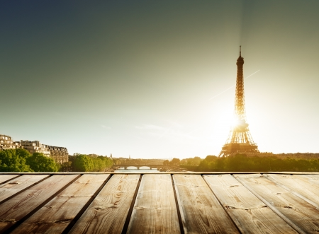background with wooden deck table and  Eiffel tower in Paris Stock Photo - 20952372