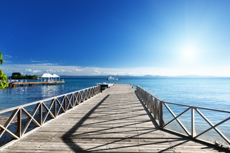 wooden pier in caribbean sea photo