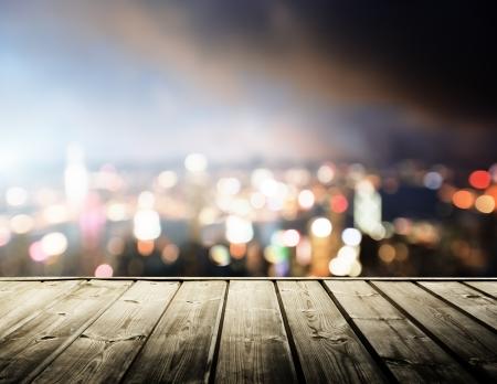 bokeh: wooden platform and lights of night Hong Kong