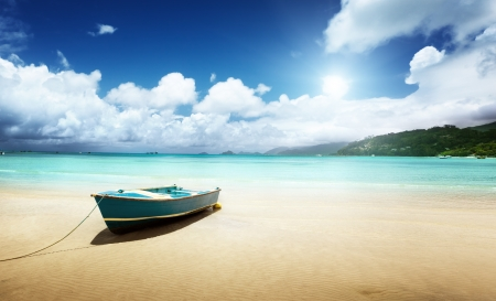 boat on beach Mahe island, Seychelles photo
