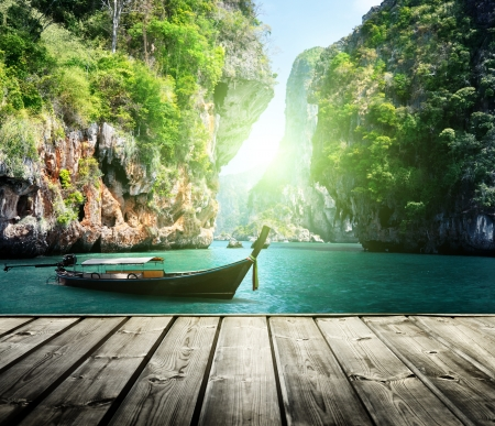 long boat and rocks on railay beach in Krabi, Thailand Stock Photo - 22412789