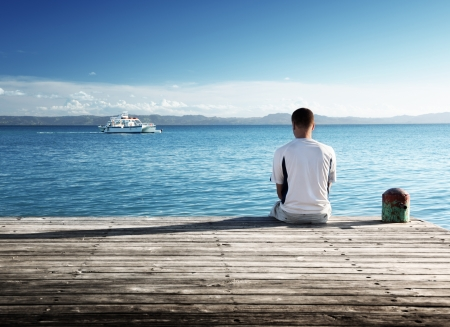 sitting man: young man relax siting on pier