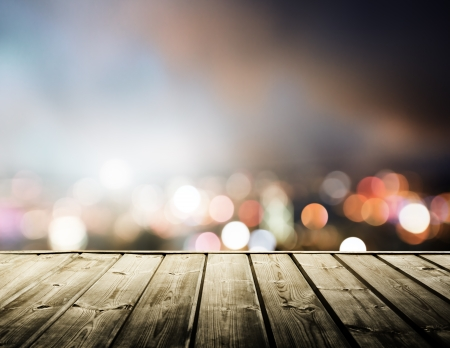 blurred lights: wooden platform and lights of night Hong Kong
