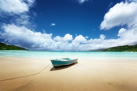 boat on beach Mahe island, Seychelles photo
