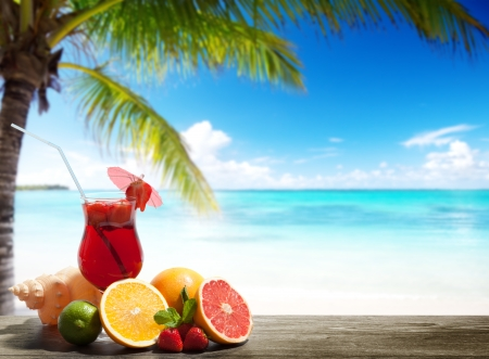 strawberry cocktail and tropical fruit on the beach photo