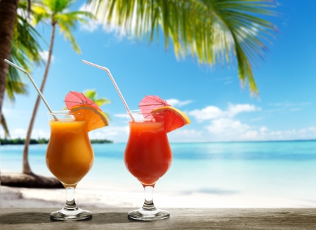 Two fresh juices on beach photo
