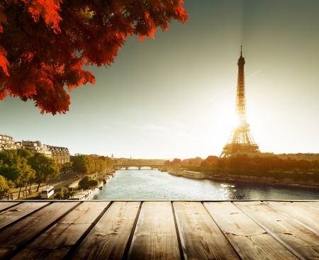 wooden deck table and  Eiffel tower in autumn photo