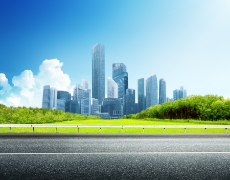 town modern home: Asphalt road and modern city  Stock Photo