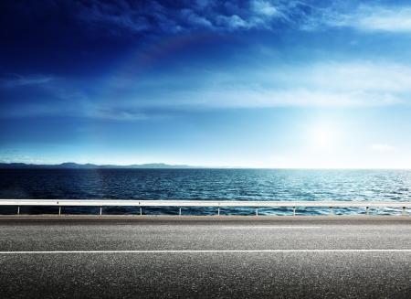 road side: asphalt road and sea