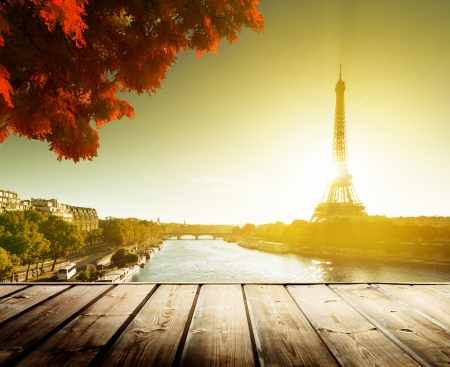 wooden deck table and  Eiffel tower in autumn Stock Photo