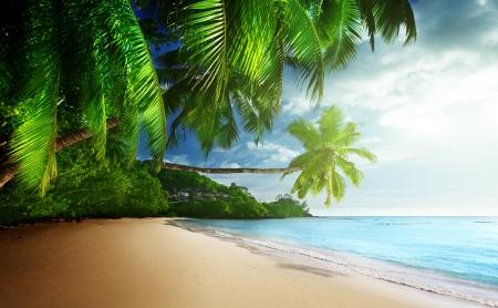 anse: sunset on beach Anse Takamaka of Mahe island, seychelles