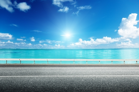 side road: asphalt road and sea