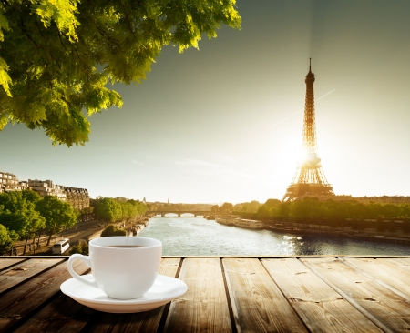 coffee on table and Eiffel tower in Paris  photo