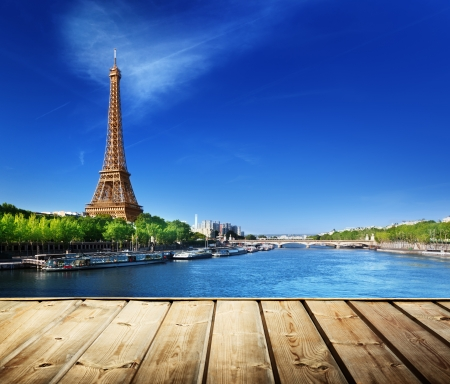 eiffel tower: background with wooden deck table and Eiffel tower in Paris