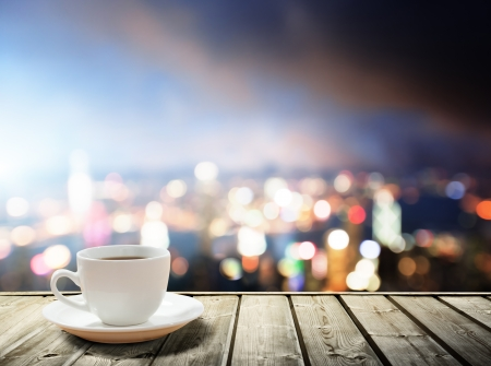 morning breakfast: coffee on table in the night city