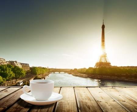 eiffel: coffee on table and Eiffel tower in Paris