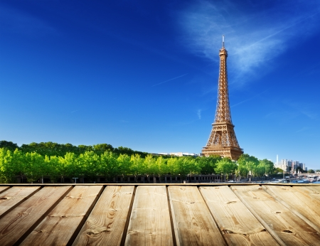 background with wooden deck table and Eiffel tower in Paris Stock Photo - 23486989