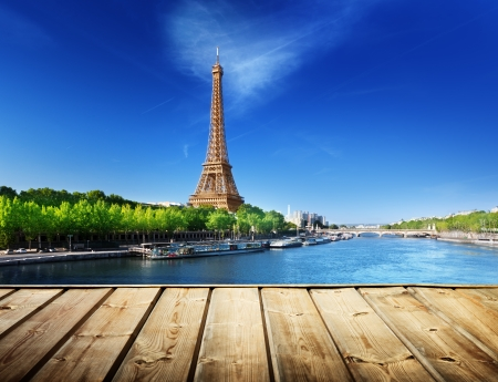 background with wooden deck table and Eiffel tower in Paris Stock Photo - 23651968
