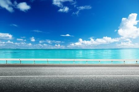 アスファルトの道路と海 写真素材