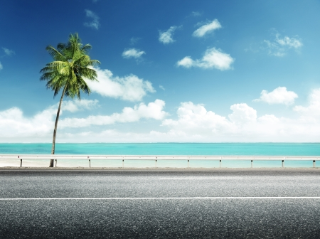 asphalt road and sea