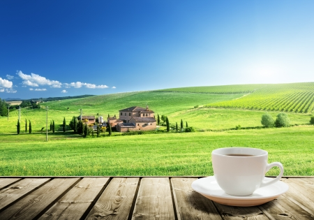 farmhouses: cup coffee and tuscany landscape, Italy