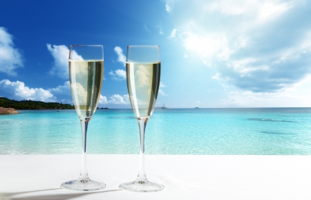 beach summer: champaign Glasses on beach Stock Photo