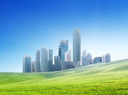 spring field and modern city  Stock Photo