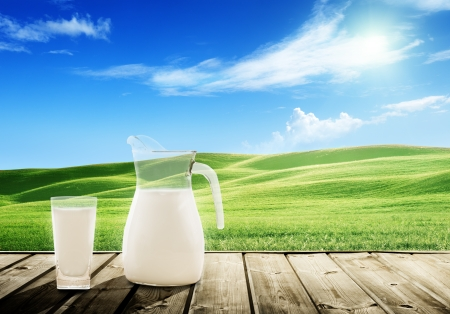 milk and sunny spring field Stock Photo