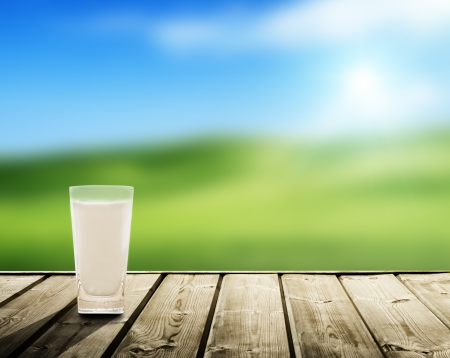field glass: milk and sunny spring field Stock Photo