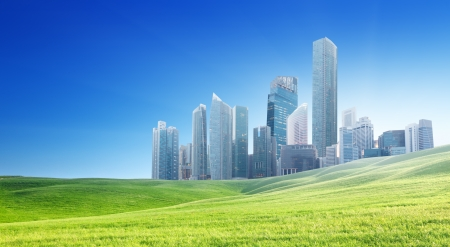 commercial activity: spring field and modern city  Stock Photo