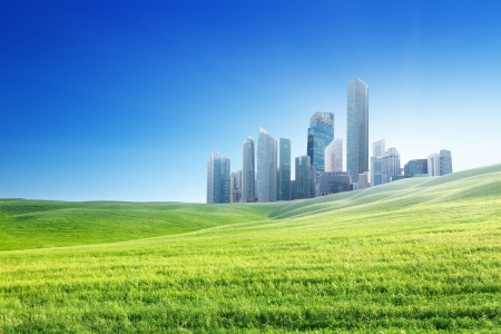 city park skyline: spring field and modern city  Stock Photo
