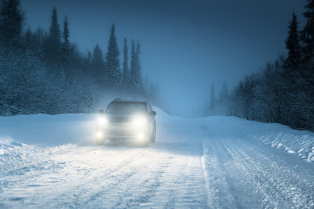 Car lights in winter Russian forest Stock Photo - 25715995