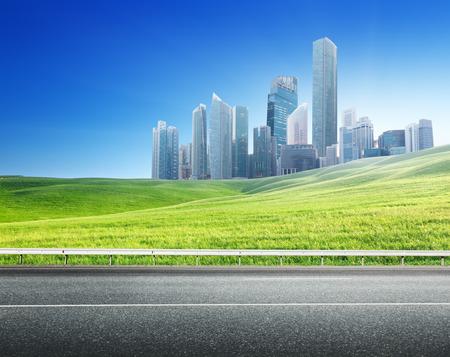 side road: Asphalt road and modern city  Stock Photo