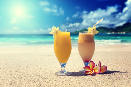 cocktail drinks: fresh fruit juices on a tropical beach Stock Photo