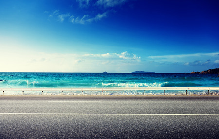 drive way: road and sea in sunset time Stock Photo