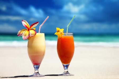 fresh fruit juices on a tropical beach Stock Photo