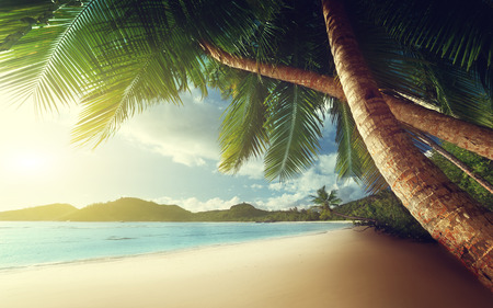 sunset on beach Anse Takamaka of Mahe island, seychelles Stock Photo