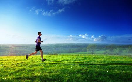 sunset and running young man  Standard-Bild