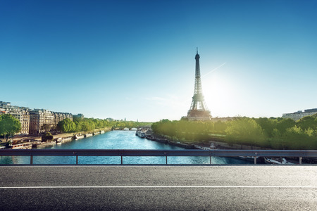 Eiffel Tower and road in sunrise time photo