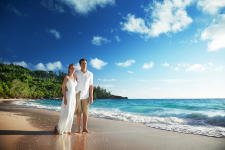 man and woman romantic couple on tropical beach  photo