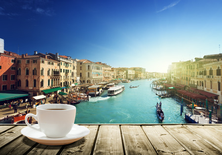 coffee on table and Venice in sunset time, Italy photo