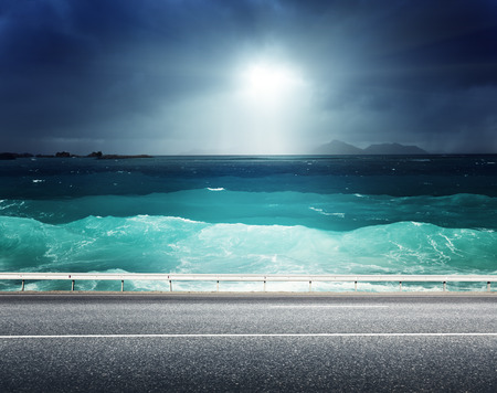 asphalt road and sea  photo