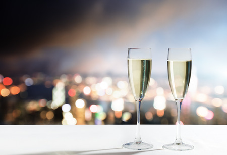botle: champagne Glasses and night city