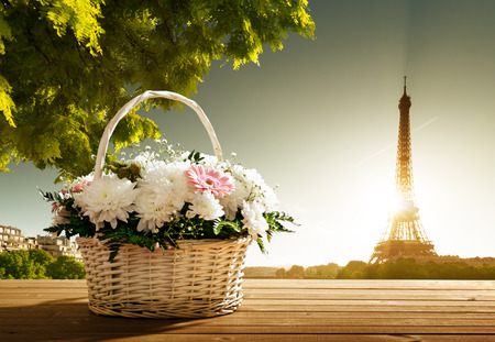 flowers in basket and Eiffel tower, Paris photo