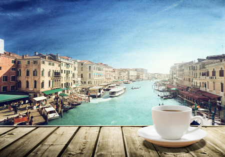 coffee on table and Venice in sunset time, Italy Imagens