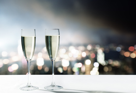 atmosphere: champagne Glasses and night city