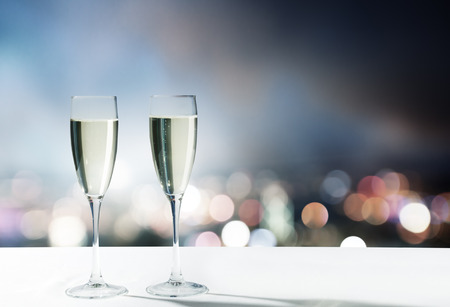 night table: champagne Glasses and night city