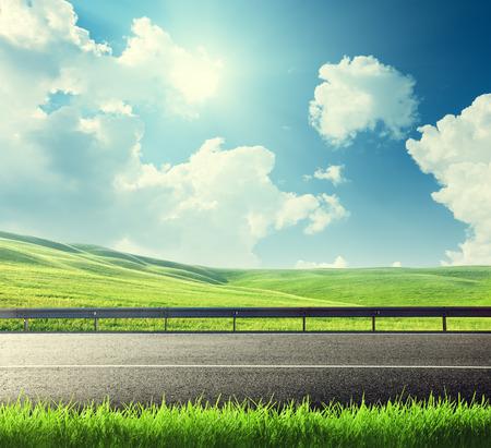 road and spring grass Фото со стока
